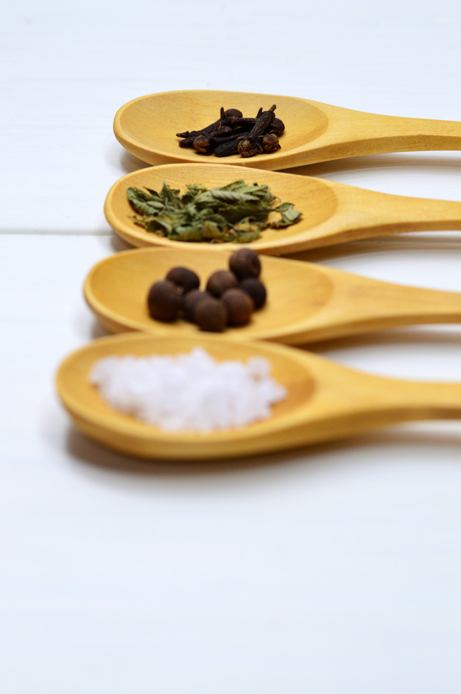 four spoons with spices