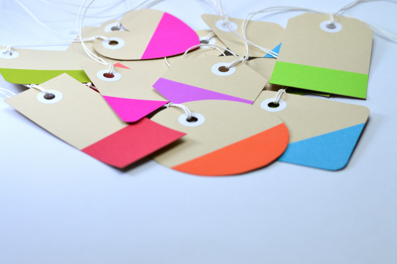 bunch of colorful paper tags on white background