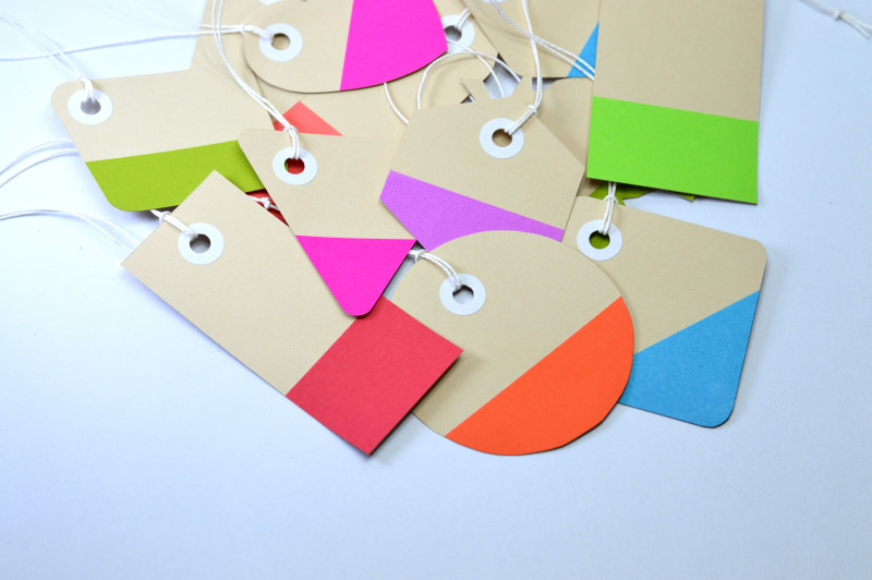 colorful paper tags on white background