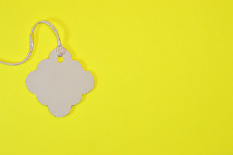 decorated paper tag on yellow background