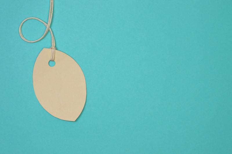 leaf paper tag on light blue background