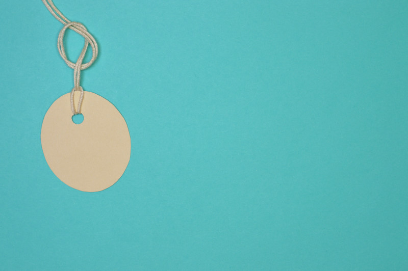 oval paper tag on light blue background