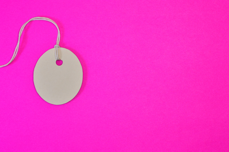 oval paper tag on pink background