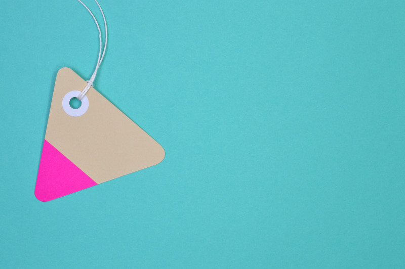 triangle paper tag on light blue background