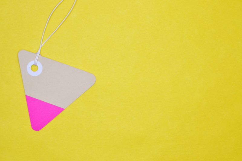 triangle paper tag on yellow background