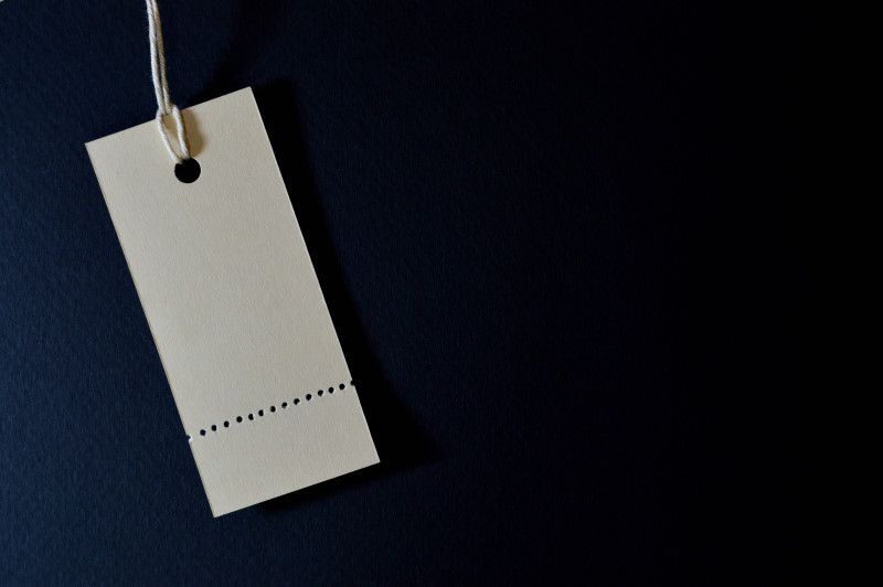 vertical paper tag on dark background