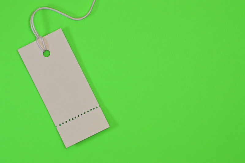 vertical paper tag on green background
