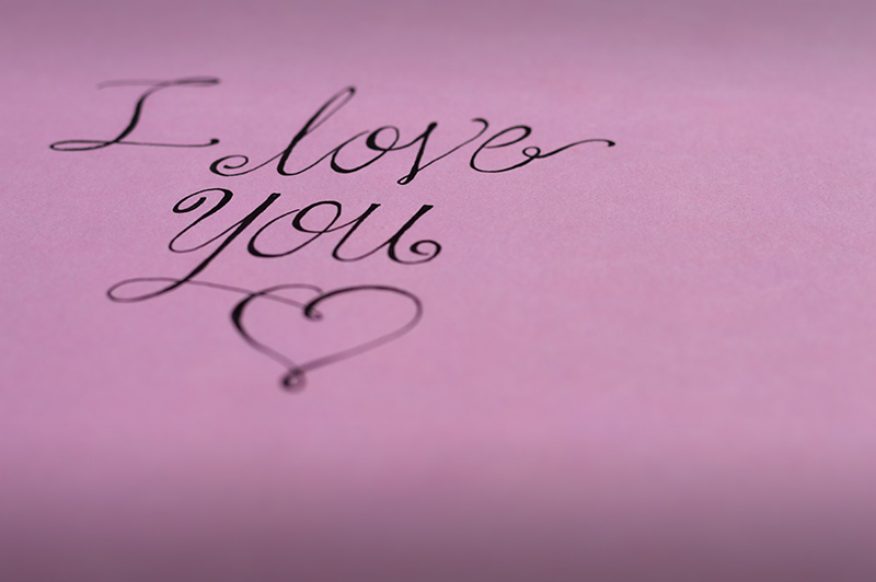 i love you lettering on pink paper