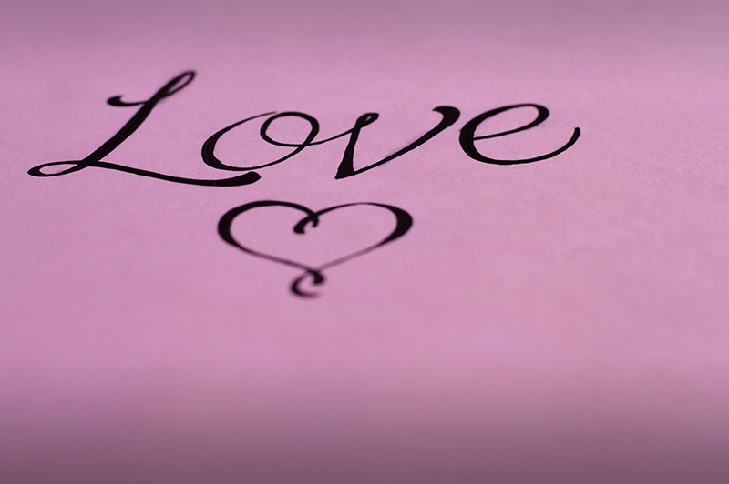 love lettering on pink paper
