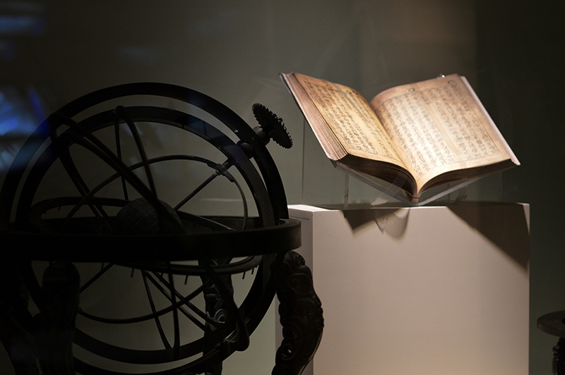 spherical astrolabe and book